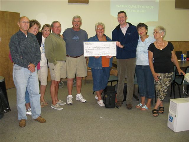 Six Mile lake Association presents a check to the Little Traverse Conservancy
