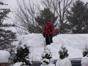 SMLA Member Shoveling His Roof